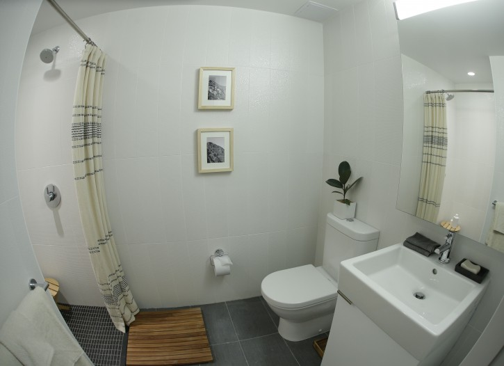 "In this Dec. 22, 2015, photo, small decorations complete the look of one of the bathrooms for viewing inside one of the completed apartments at Carmel Place in New York. As the city-sponsored ""micro-apartment"" project nears completion, it's setting an example for tiny dwellings that the nation's biggest city sees as an aid to easing its affordable housing crunch. (AP Photo/Julie Jacobson)"