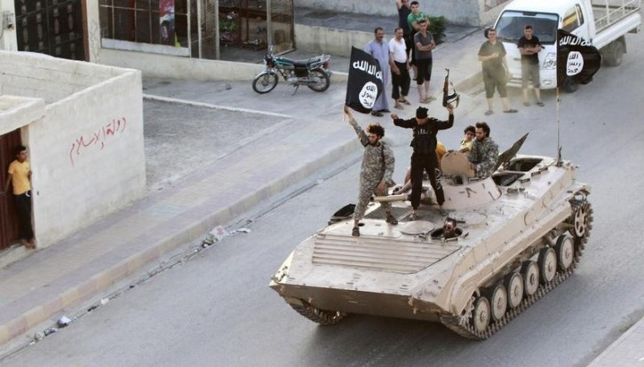 FILE - Militant Islamist fighters take part in a military parade along the streets of northern Raqqa province June 30, 2014. Reuters