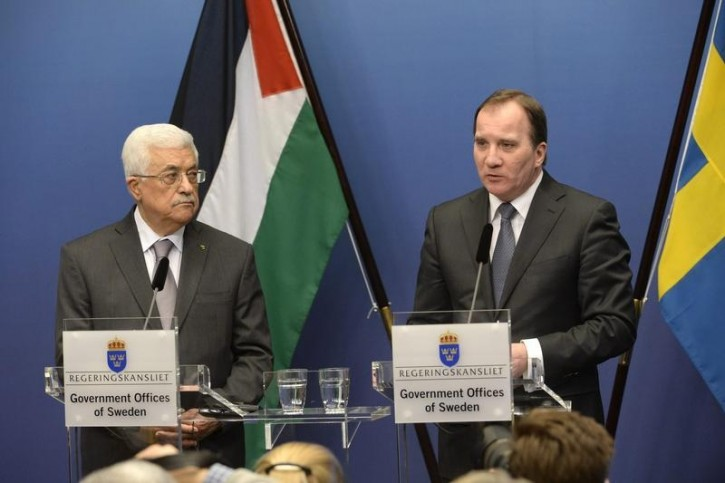 FILE - Sweden's Prime Minister Stefan Lofven (R) speaks during a joint news conference with Palestinian President Mahmoud Abbas at the Rosenbad government headquarters in Stockholm February 10, 2015.  Reuters