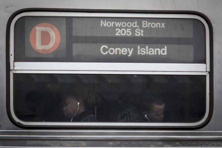 FILE - People are photographed through the window as they ride the D train subway heading toward Coney Island in the Brooklyn borough of New York October 3, 2015. REUTERS/Carlo Allegri -