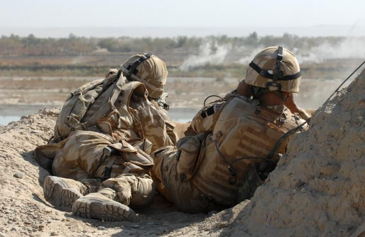 FILE - British Army Gurkha snipers observe a position after they were fired on during a patrol in an area known as Hamburger Hill in Helmand province, Afghanistan November 6, 2007.  Reuters