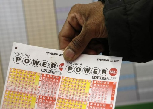 FILE - A man holds the tickets he purchased for Virginia's Powerball lottery in Arlington, Virginia February 19,  2014.REUTERS
