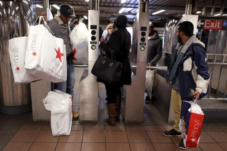 FILE - Shoppers enter the Herald Square Subway station after early morning Black Friday Shopping in New York November 27, 2015. REUTERS/Brendan