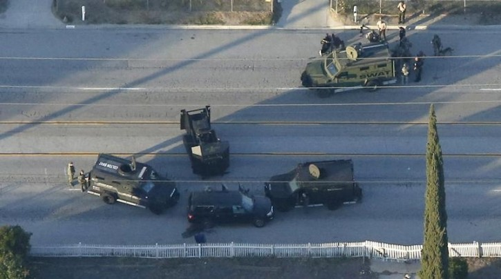 An SUV with its windows shot out that police suspect was the getaway vehicle from at the scene of a shooting in San Bernardino, California is shown in this aerial photo December 2, 2015. REUTERS