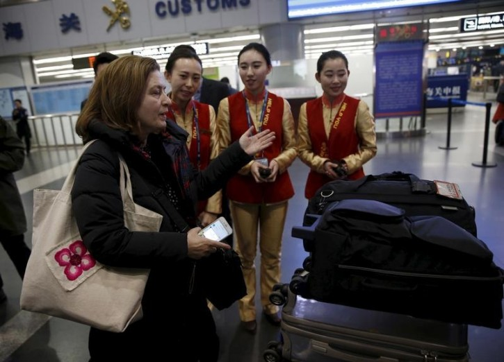 Ursula Gauthier, a reporter for the French current affairs magazine L'Obs, arrives at Beijing international airport for departure to France, in Beijing December 31, 2015. REUTERS