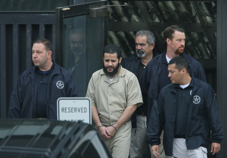 FILE - In this Sept. 18, 2014 photo, Mufid Elfgeeh is taken out of Federal Court in Rochester, N.Y.    Elfgeeh,  a naturalized U.S. citizen, helped arrange travel and funding and put one recruit in touch with an English-speaking Islamic State contact in Iraq via Facebook, authorities said on Thursday, Dec. 17, 2015.(Carlos Ortiz/Democrat & Chronicle via AP)
