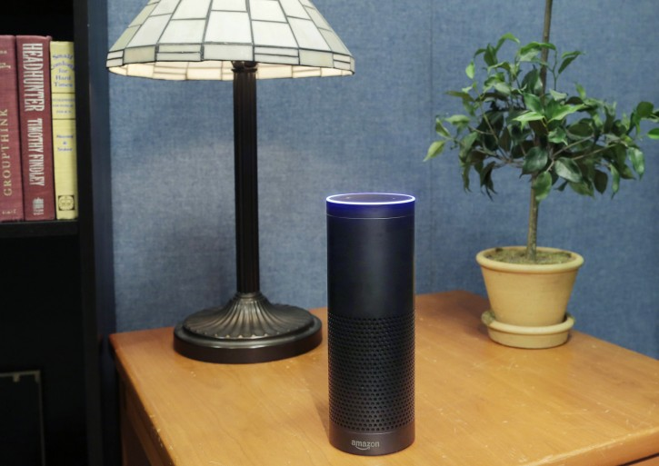 "FILE - This July 29, 2015 file photo made in New York shows Amazon's Echo, a digital assistant that continually listens for commands such as for a song, a sports score or the weather. The company says Echo transmits nothing to Amazon's data centers until you first say ""Alexa"" or press a button. A blue light also comes on to let you know it's active. (AP Photo/Mark Lennihan, File)"