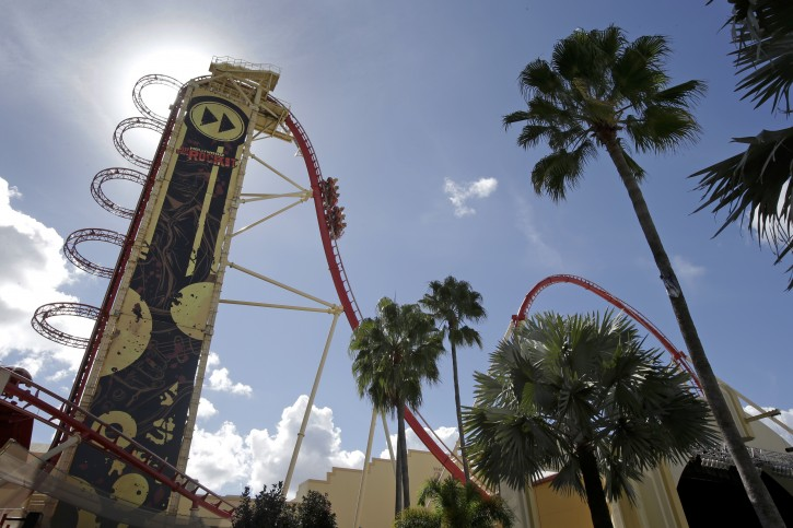 In this Thursday, Oct. 22, 2015 photo, guests ride the Hollywood Rip Ride Rocket roller coaster at Universal Studios in Orlando, Fla. In the last 25 years, Universal Orlando has emerged from the shadow of its older sister park to forge its own identity celebrating the entertainment industry. (AP Photo/John Raoux)