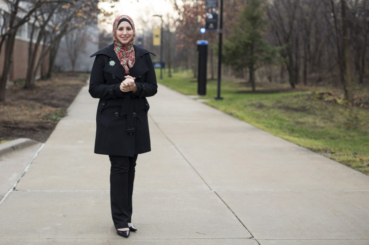 Suehaila Amen, coordinator of International Admissions and Recruitment at the University of Michigan Dearborn, is seen on campus, Thursday, Dec. 10, 2015 in Dearborn, Mich. Amid the high level of harassment, threats and vandalism directed at American Muslims and at mosques, Muslim women are intensely debating the duty and risks related to wearing their head-coverings as usual. (AP Photo/Tim Galloway)