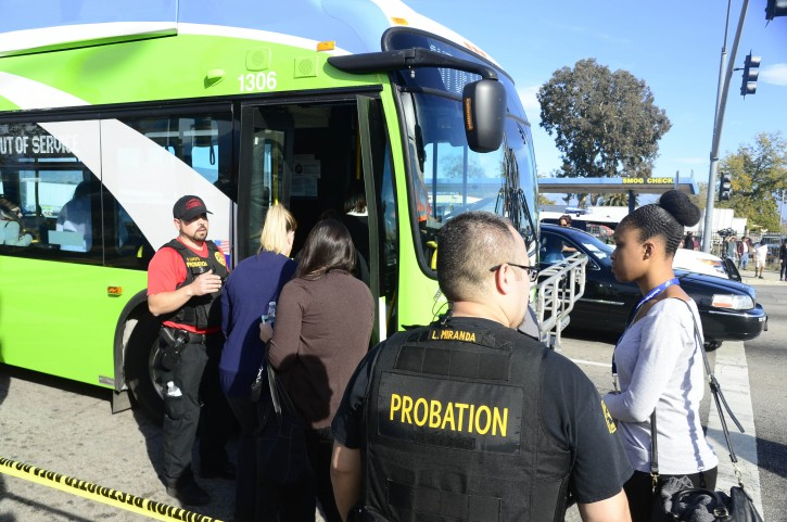 Law enforcement officers escort people onto a bus as they are evacuated from the scene of a shooting at the Inland Regional Center in San Bernardino, California, USA, 02 December 2015. A shooting at a government building west of Los Angeles left 'upwards of 14 people' dead and at least 14 wounded, San Bernardino Police Chief Jerrod Burguan says.  EPA/MIKE NELSON
