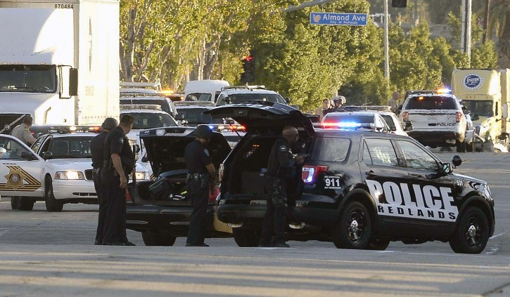 Law enforcement officers deploy near the scene where suspects in the shooting at the Inland Regional Center were reportedly apprehended in San Bernardino, California, USA, 02 December 2015. At least 14 people were reportedly killed and 17 wounded in the shooting.  EPA/MIKE NELSON