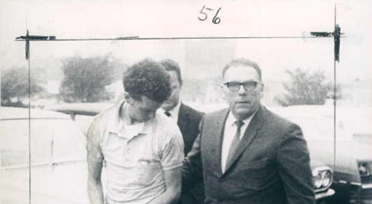 Wayne Stephen Young, charged in the slaying of Esther Lebowitz, is taken into Baltimore police headquarters by homicide detective Sgt. Harry Bannon in this 1969 photo. Young, who has been behind bars since then, died on Dec. 23, 2015. (Photo by Baltimore Sun Courtesy to VINnews.com)