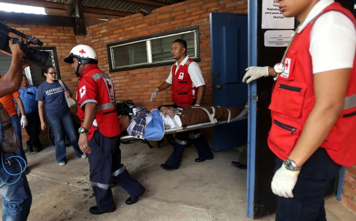 This photo courtesy of El Heraldo de Honduras newspaper shows an unidentified person being carried into the Valle de Angeles Adventist Hospital after being involved in a bus accident along the highway between the town of San Juancito and the capital city of Tegucigalpa, Honduras, Wednesday, Jan. 13, 2016.  AP