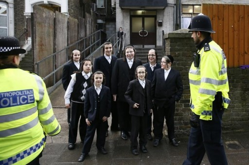FILE - Police officers patrol in a Jewish neighbourhood in north London January 17, 2015. REUTERS/Stefan Wermuth