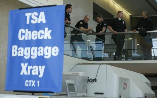 FILE - Airport police stand in the TSA area of terminal 1 at Los Angeles airport (LAX), California November 1, 2013. REUTERS