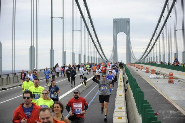 Runners make their way across the Verrazano-Narrows Bridge during the start of the New York City Marathon.REUTERS
