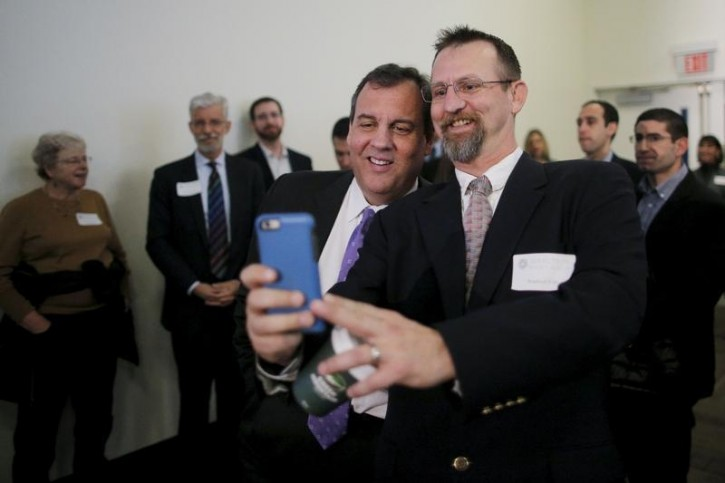 U.S. Republican presidential candidate and New Jersey Governor Chris Christie (C) poses for a selfie before speaking at the New Hampshire Forum on Addiction and Heroin Epidemic in Hooksett, New Hampshire, January 5, 2016. REUTERS/Brian Snyder