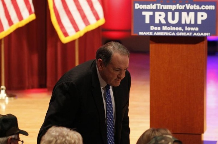 """Republican U.S. presidential candidate and former Arkansas Governor Mike Huckabee arrives at rival candidate Donald Trump's """"Rally to Benefit Veterans"""" taking place at the same time as the Republican presidential candidates debate in Des Moines, Iowa January 28, 2016. REUTERS/Rick Wilking"""