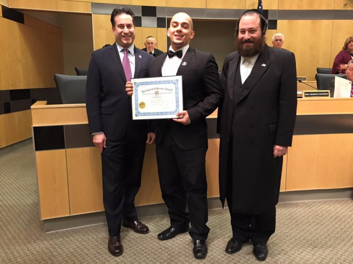 Joey Resto, center, was honored for his act of kindness by Rockland County Legislators Aron B. Wieder, right, and Alden H. Wolfe, left, and their colleagues on the board.