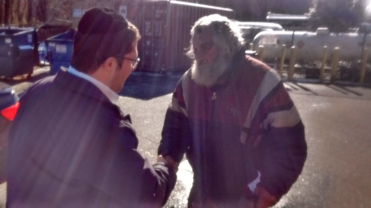 Lakewood Orthodox Jewish prankster who Officlas say is mentally disabled apologizes to the homeless man for his behavior. (Facebook Carlos Mejia)
