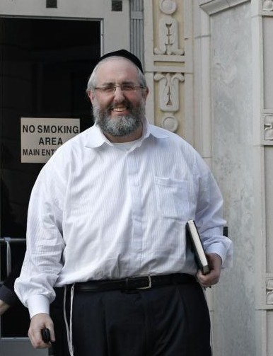 FILE - Rabbi David Wax, 51, is shown walking out of federal court in Trenton, N.J., in 2011. AP