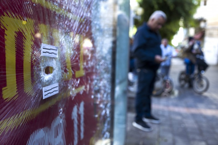 A bullet hole in a bus stops advertising panel in front of the cafe in central Tel Aviv, Israel, 02 January 2016, where an Israeli-Arab man opened fire with an automatic weapon killing two people on 01 January 2016. EPA