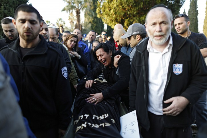 Alon Bakal's mother Nitza Bakal (C) cries in mourning as relatives carry the coffin of her son Alon Bakal during his funeral in the northern city of Karmiel, Israel, 03 January 2016. Alon Bakal was killed after an Israeli Arab identified by the police as Nashat Melhem opened fire at a bar in central Tel Aviv on 01 January killing two people and injured eight. Police are still on a heavy searching for the gunman.  EPA/ABIR SULTAN