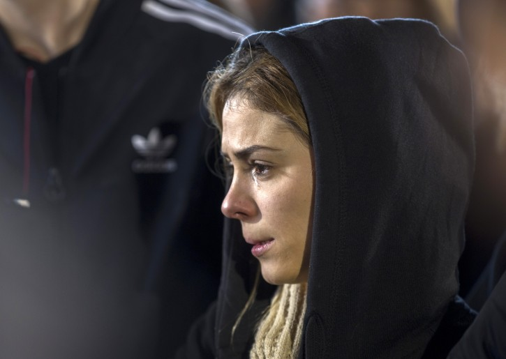A friend of Shimon Ruimi mourns with tears running down her cheek during funeral services at the cemetery in the  southern Israeli town of Ofakim, 03 January 2016.  EPA