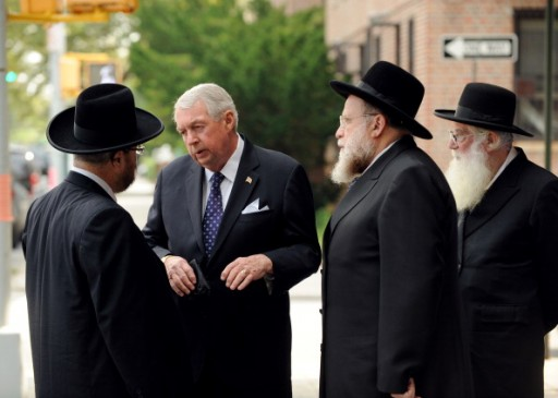 FILE - District Attorney Charles Hynes (c.) speaking to to Rabbi Gershon Tannenbaum outside the the home of murder victim Leiby Kletzky on 15th Ave. in Borough Park, Brooklyn observing shiva. July 19, 2011 (Photo By: Mark Bonifacio/NY Daily News via Getty Images)