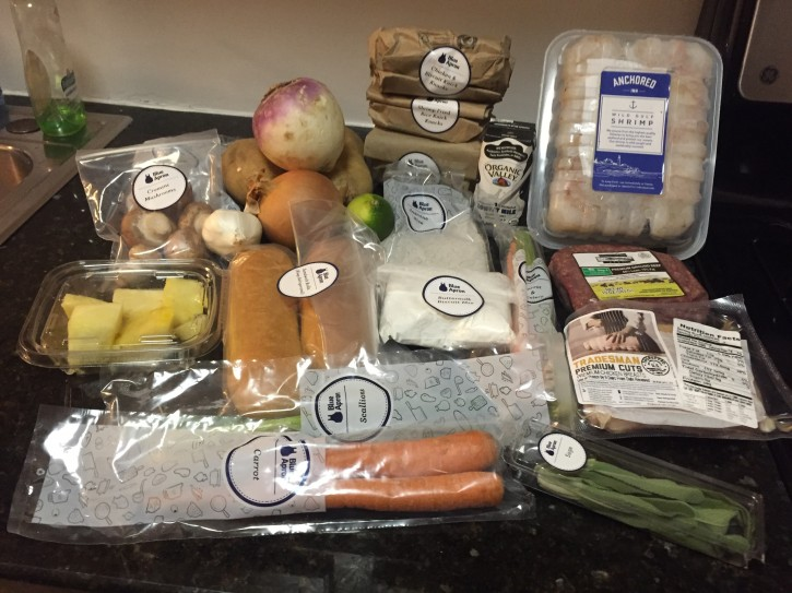 This Jan. 26, 2016, photo, shows ingredients from a three-meal Blue Apron box in New York. An industry has emerged supplying home-delivered meals in a box. But can a subscription service that delivers kits of pre-measured ingredients and recipes be a cost-effective and healthy solution? (AP Photo/Bree Fowler)