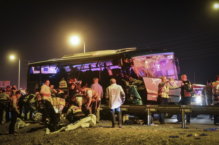 Medical and Rescue personnel evacuate wounded and killed passengers from the scene where a bus crashed into a truck pulled over on Road 1 near Latrun interchange, on February 14, 2016. Photo by Flash90