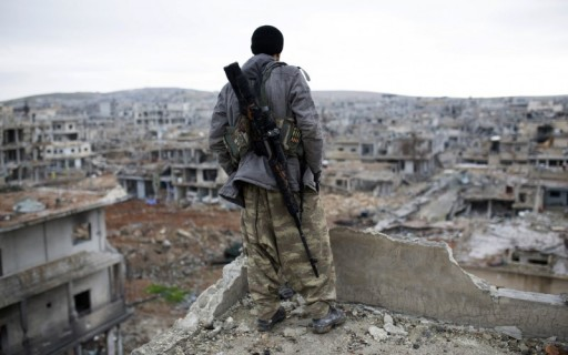 File: A sniper looks at the rubble in Syria. (Photo AP)