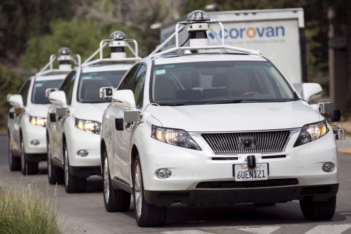 FILE - A line of Lexus SUVs equipped with Google self-driving sensors await test riders during a media preview of Google's prototype autonomous vehicles in Mountain View, California September 29, 2015.  REUTERS/Elijah Nouvelage