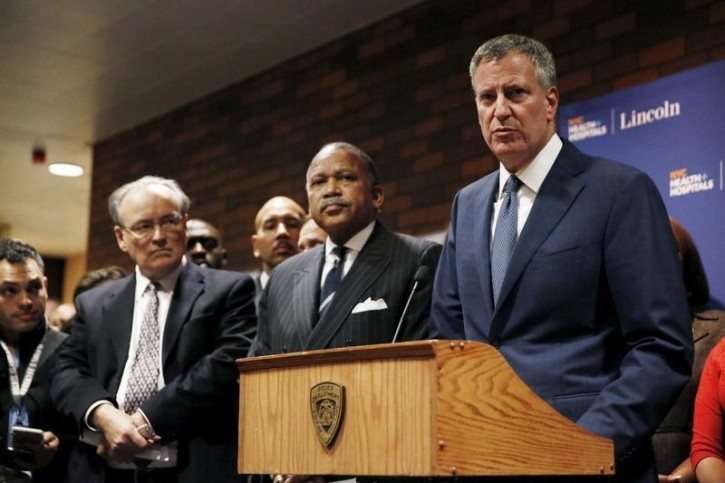 FILE - New York City Mayor Bill de Blasio addresses media gathered at Lincoln Hospital following the shooting of two New York Police Officers in the Bronx borough of New York February 4, 2016. REUTERS/Andrew Kelly