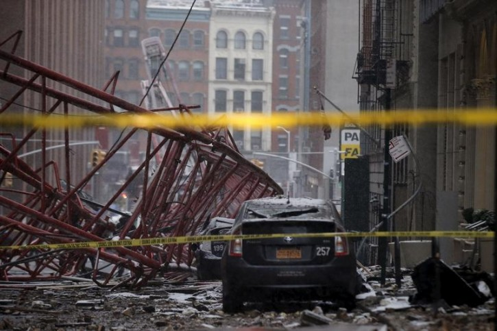 A 565-foot-tall construction crane is seen toppled on the ground in downtown Manhattan in New York, February 5, 2016.  Reuters