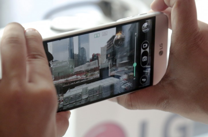 In this Feb. 11, 2016 photo, the LG G5 smartphone is used to take a photo as the device is demonstrated in New York. The main camera on the G5 will have two lenses, one for standard shots, and one with a wider angle so you can capture more of what's in front of you without having to step back.(AP Photo/Bebeto Matthews)
