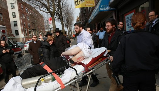 25 year old Yehuda Leib Brikman getting medical attention after being stabbed in Crown Heights yesterday. (Crownheights.info)