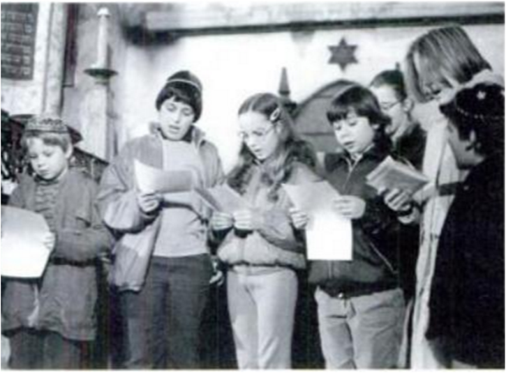 FILE -  11 year old David is seen on far left preparing for a Chanukah Play in his home country Prague (A Tree Still Stands: Jewish Youth in Eastern Europe Today<br /> By Yale Strom)