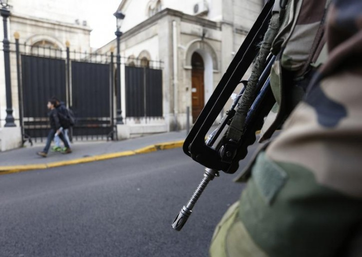 FILE - A member of the French Foreign Legion secures the access to a Jewish synagogue in France. January 13, 2015.  Reuters