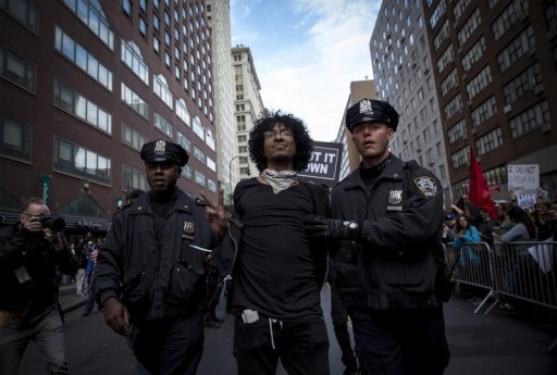 FILE - A protester is arrested by New York City Police officers (NYPD) during a demonstration in New York May 1, 2015. REUTERS