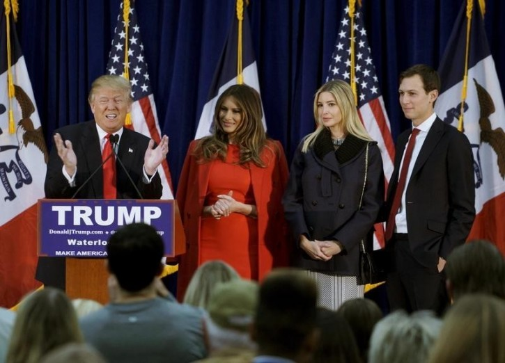 U.S. Republican presidential candidate Donald Trump speaks as (L-R) his wife Melania, daughter Ivanka and Ivanka's husband Jared Kushner listen, at a campaign rally on caucus day in Waterloo, Iowa February 1, 2016. REUTERS/Rick Wilking