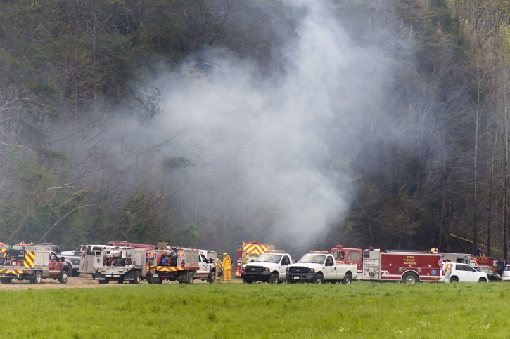 Emergency vehicles respond to the scene of a fatal helicopter crash, Monday, April 4, 2016, in Pigeon Forge, Tenn. A sightseeing helicopter crashed near the Great Smoky Mountains National Park in eastern Tennessee, officials said. (Saul Young/Knoxville News Sentinel via AP)
