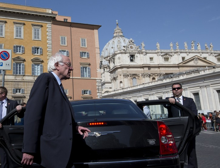 US presidential candidate Bernie Sanders, backdropped by St. Peter's Basilica, leaves after an interview with the Associated Press, at the Vatican Saturday, April 16, 2016. AP