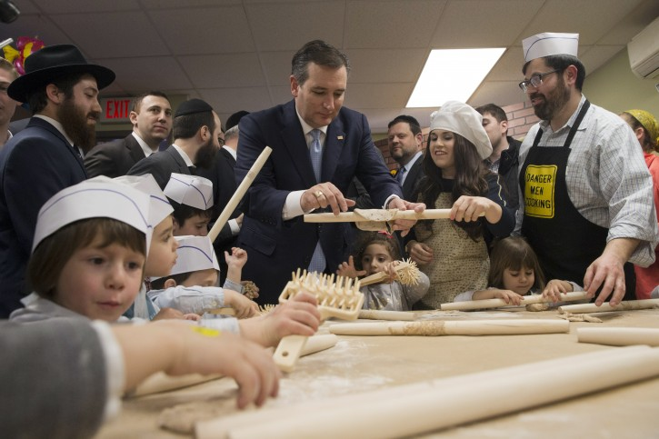 Republican presidential candidate, Sen. Ted Cruz, R-Texas, makes matzah at the Chabad Neshama Center, during a campaign event, Thursday, April 7, 2016, in New York. (AP Photo/Mary Altaffer)