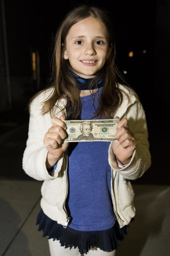 In this Wednesday, April 20, 2016, photo, Sofia, 11, stands with a U.S. $20 bill outside of her home in Cambridge, Mass. Sofia, who wrote a letter to President Barack Obama urging him to put a woman on U.S. paper currency has gotten her wish. Treasury Secretary Jacob Lew announced Wednesday that African-American abolitionist Harriet Tubman will be featured on the front of the $20 bill. (Ryan Mcbride/Boston Herald via AP)