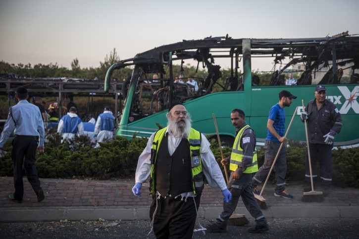 Israeli police and rescue workers at the scene of a possible bus bombing, in jerusalem, on April 18, 2016, leaving at least 15 people injured. Police are investigating if the incident was a terror attack. The explosion occured on bus 12, while passing by the neighborhood of Talpiot, the bus was empty at the time, the injuries were from people on an adjacent bus. Photo by Hadas Parush/FLASh90