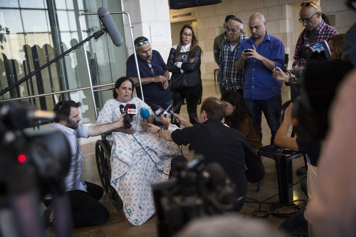 Rachel Dadon speaks with the press at Hadassa Ein Karem hospital where she and her daughter are hospitalized after being injured from the bus bombing that took place in Jerusalem, on April 19, 2016. Flash90