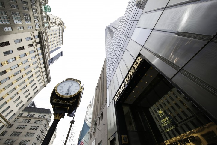FILE - In this March 16, 2016 file photo, Trump Tower, right, the residence of Republican presidential candidate Donald Trump, rises above Fifth Avenue in New York. The Republican front-runner's gilded home turf turns into a daily New York town square of political chatter that's a cross-section of the world. (AP Photo/Mark Lennihan)