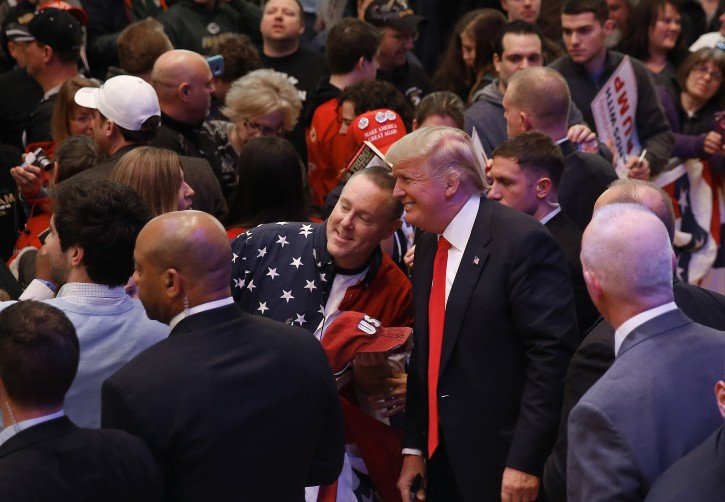 Republican presidential candidate Donald Trump poses for a photograph at a campaign event, Saturday, April 2, 2016, in Racine, Wisc. (AP Photo/Paul Sancya)