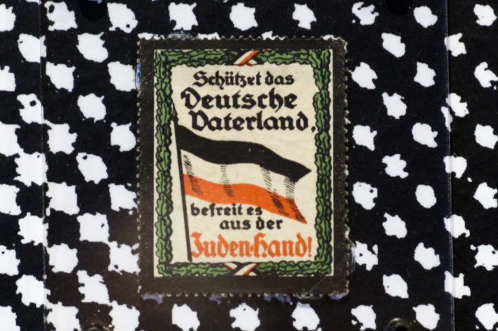 A sticker from around 1900 reading: 'Protect the German fatherland - liberate it from the Jewish hand! ' is displayed at an exhibition of antisemitic and racist stickers at the Deutsches Historisches Museum, German Historic Museum, in Berlin, Germany, Tuesday, April 19, 2016. One of Germany's main history museums is exhibiting racist and anti-Semitic stickers spanning more than a century, a show that comes as the country worries about racism amid the migrant crisis. (AP Photo/Markus Schreiber)